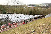 Rails are dragged forward from the train onto the new sleepers approximately 1km from Tweedbank.