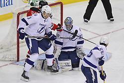 Mar 29; Newark, NJ, USA; Tampa Bay Lightning goalie Dwayne Roloson (30) makes a pad save while New Jersey Devils right wing David Clarkson (23) and Tampa Bay Lightning defenseman Keith Aulie (3) battle for the rebound during the third period at the Prudential Center. The Devils defeated the Lightning 6-4.