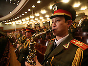 A Chinese soldier plays his national anthem at the opening session of China's CPPCC, or congress in Beijing.