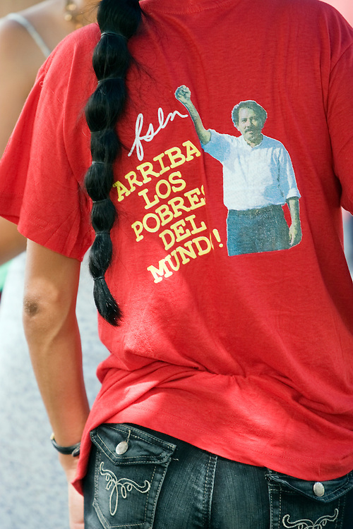 "An FSLN supporter wears a political tee shirt that reads ""arise the poor of the world."" and shows Daniel Ortega with his fist raised in a salute. The Sandinista party has re taken power in Nicaragua during elections in 2007. However, Ortega's ratings continue to slide."