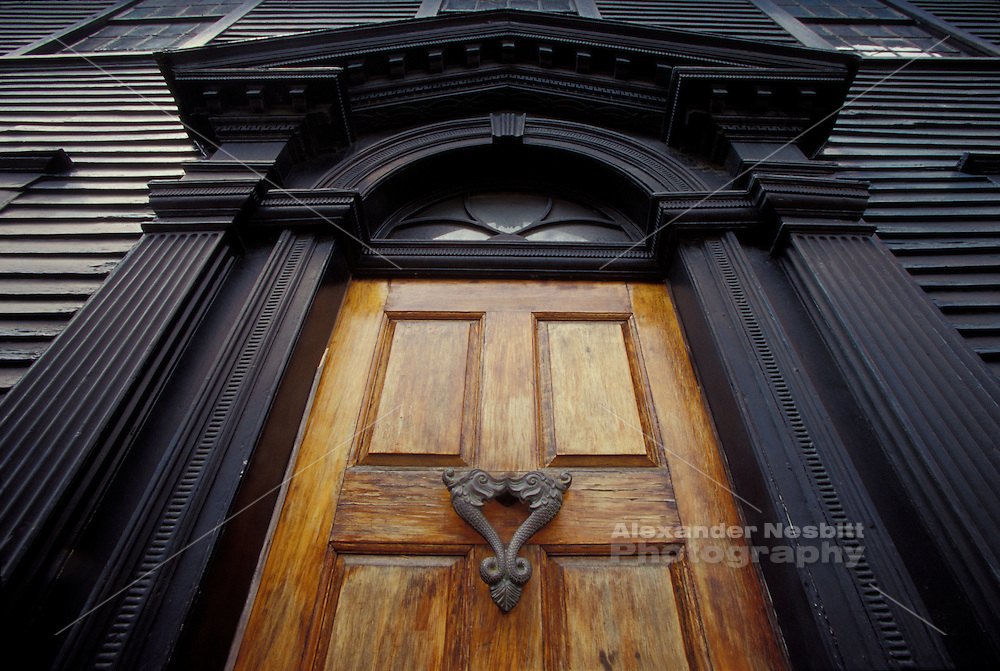 Newport, RI USA. - Door on a colonial home on Spring street with elaborate Greek Revival details and an ornate maritime bronze door knocker.