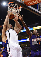 Nov 15, 2013; Phoenix, AZ, USA; Brooklyn Nets forward Mason Plumlee (1) goes up with the ball against the Phoenix Suns center Viacheslav Kravtsov (55) and guard Eric Bledsoe (2) in the first half at US Airways Center. The Nets defeated the Suns 100-98 in overtime. Mandatory Credit: Jennifer Stewart-USA TODAY Sports