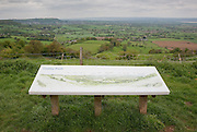 Represented landscape. The sign at Coaley peak indicating points of interest with views across the Severn valley to the Brecon Beacons in Wale in the Distance