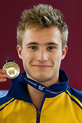 Jack Laugher of City of Leeds Dive Club poses with his Gold Medal after Winning the Mens 3m Springboard Final - Photo mandatory by-line: Rogan Thomson/JMP - 07966 386802 - 21/02/2015 - SPORT - DIVING - Plymouth Life Centre, England - Day 2 - British Gas Diving Championships 2015.