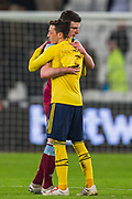 Declan Rice (West Ham) delighted to receive the shirt from Mesut Ozil (Arsenal) during the Premier League match between West Ham United and Arsenal at the London Stadium, London, England on 9 December 2019.