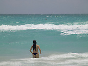 woman waiting for a wave to arrive Miami USA