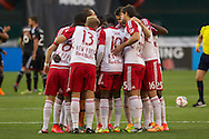 Red Bulll players huddle before the start of the match against DC United. Red Bull NY rallied back to tie DC United 2-2 at RFK Stadium in Washington D.C. on Saturday April 11, 2015.