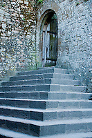 Old stone stairs, portal and wooden door at Mont-Saint-Michel, France