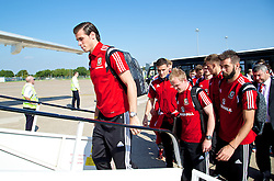 CARDIFF, WALES - Sunday, September 7, 2014: Wales' Gareth Bale boards the plane at Cardiff Airport as the squad flies to Andorra ahead of the opening UEFA Euro 2016 qualifying match. (Pic by David Rawcliffe/Propaganda)