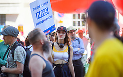 © Licensed to London News Pictures. 30/06/2018. London, UK. Thousands of people take part in a march through central London to mark the 70th anniversary of the NHS. The UK's National Health Service was launched on July 5th, 1948 as part of major social reforms following the Second World War. Photo credit: Ben Cawthra/LNP