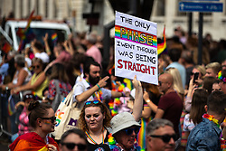 """© Licensed to London News Pictures . 05/08/2018. Leeds, UK. """" The only phase I went through was being straight """" placard . Leeds Gay Pride parade through the Yorkshire city's centre . Leeds's annual Gay Pride festiva celebrates the city's LGBTQ+ life and culture . Photo credit: Joel Goodman/LNP"""