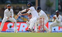 August 4, 2017 - Colombo, Sri Lanka - Indian cricket captain Virat Kohli (L) and Indian wicket keeper ..Wriddhiman Saha (3L) look on as Sri Lankan cricketer Kusal Mendis(2L) plays a shot  during the 2nd Day's play in the 2nd Test match between Sri Lanka and India at the SSC international cricket stadium at the capital city of Colombo, Sri Lanka on Friday 04 August 2017. (Credit Image: © Tharaka Basnayaka/NurPhoto via ZUMA Press)