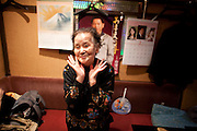 "Sugamo  Harajuku for pensioners, 90-year-old Hisako Yanagida, who chats in between belting out.traditional ballads in a musty karaoke bar called Mukashi no Uta (Songs from the Old Days).  ""Meeting and shopping with people my own age helps stop me.from going senile.""  The 1km main.shopping street, Jizo Dori, boasts 10 drugs stores and chemists, half a dozen or more outlets selling walking aids, at least two funeral arrangers and a karaoke bar where the song-list stops in the 1970s."