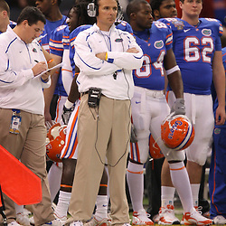 Jan 01, 2010; New Orleans, LA, USA;  Florida Gators head coach Urban Meyer watches from the sideline against the Cincinnati Bearcats during the second half of the 2010 Sugar Bowl at the Louisiana Superdome.  Mandatory Credit: Derick E. Hingle-US PRESSWIRE.