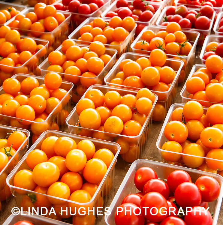 Yellow and red cherry tomatoes at a local farmer's market