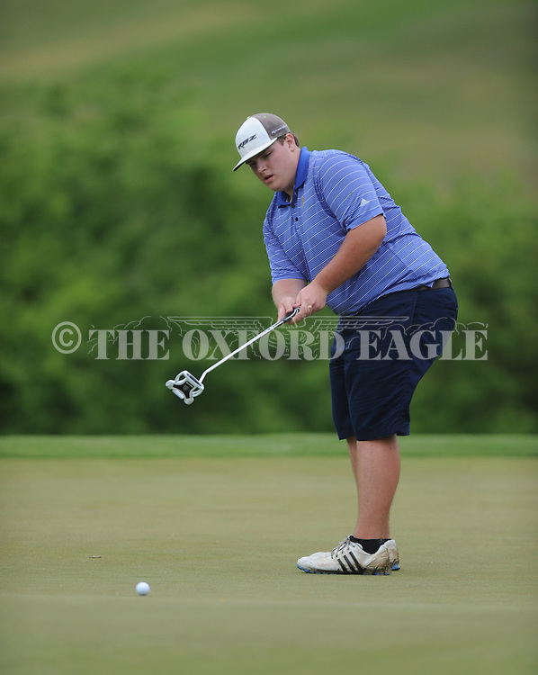 Oxford High's Ben Hubbard putts on the 17th hole during the closing round of the MHSAA Class 5A state championship golf tournament at the Ole Miss Golf Course in Oxford, Miss. on Thursday, May 2, 2013. Oxford High won to win the state championship.