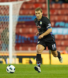 STOKE, ENGLAND - Monday, September 13, 2010: Aston Villa's Stiliyan Petrov in action against Stoke City during the Premiership match at the Britannia Stadium. (Photo by David Rawcliffe/Propaganda)