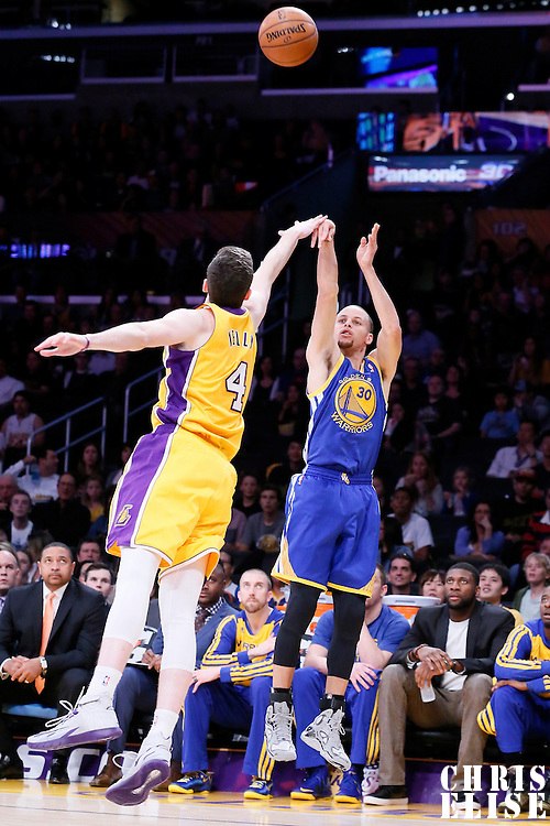 11 April 2014: Golden State Warriors guard Stephen Curry (30) takes a jumpshot over Los Angeles Lakers forward Ryan Kelly (4) during the Golden State Warriors 112-95 victory over the Los Angeles Lakers at the Staples Center, Los Angeles, California, USA.