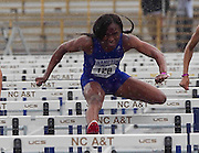 Hampton University senior Racquel Vassell wins the second heat of the Women's 100 Meter Hurdles in a torrential down pour running a 13.82 at the 2011 MEAC Track and Field Championship held at North Carolina A&T in Greensboro, North Carolina.  (Photo by Mark W. Sutton)