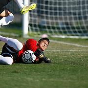 Fullerton Goal Keeper Julian Ochoa saves goal attempt from Golden West Forward. <br /> <br /> Photo by Ozzy Jaime, Sports Shooter Academy