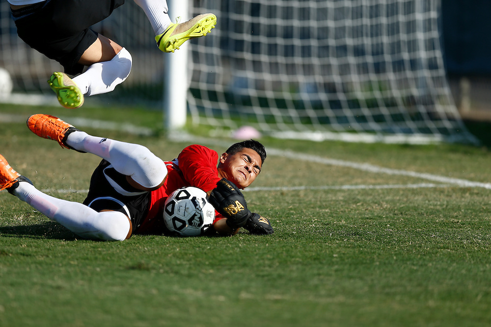 Fullerton Goal Keeper Julian Ochoa saves goal attempt from Golden West Forward. <br /> <br /> Photo by Ozzy Jaime, Sports Shooter Academy