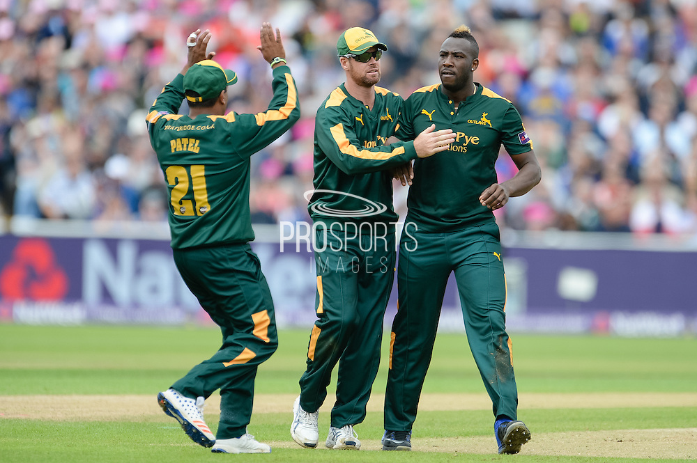 Andre Russell of Notts Outlaws (r) celebrates with Samit Patel and Dan Christian during the NatWest T20 Blast Semi Final match between Nottinghamshire County Cricket Club and Northamptonshire County Cricket Club at Edgbaston, Birmingham, United Kingdom on 20 August 2016. Photo by David Vokes.