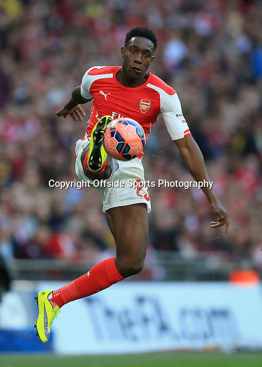 18th April 2015 - FA Cup - Semi-Final - Reading v Arsenal - Danny Welbeck of Arsenal leaps to control the ball - Photo: Simon Stacpoole / Offside.