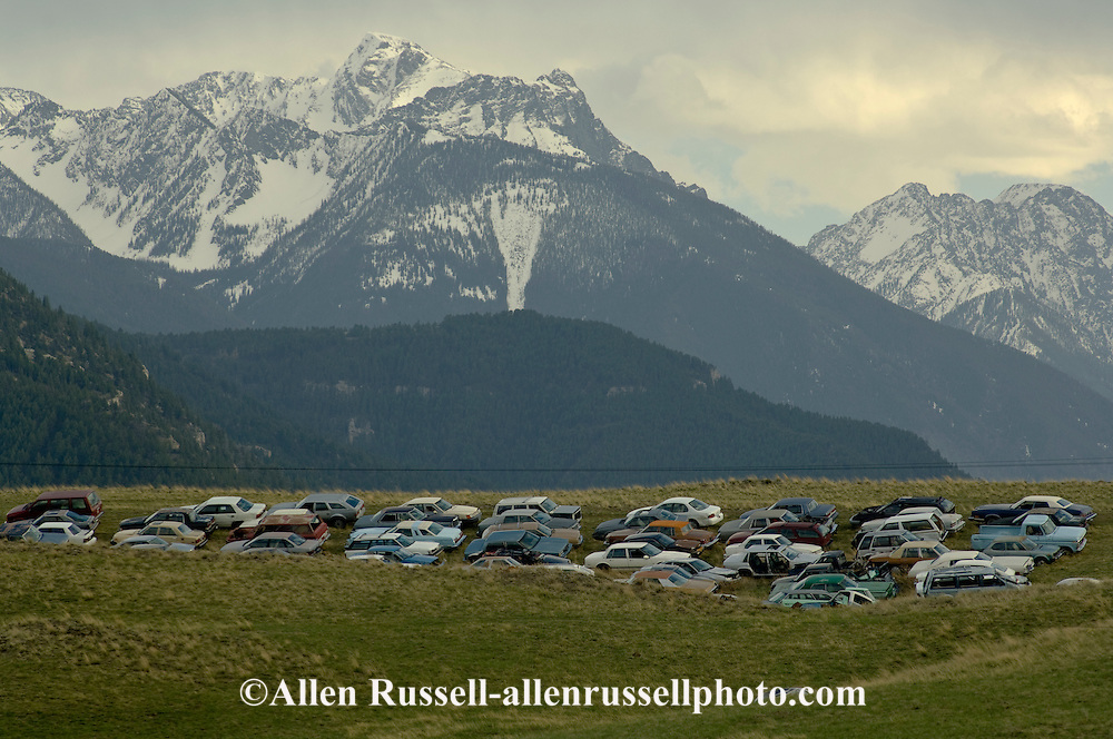 Salvage yard with Absaroka Mountains in back,  Livingston Montana