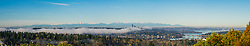 North America, United States, Washington. Panorama of Lake Washington, Seattle skyline and Olympic mountains viewed from Bellevue on a foggy day.