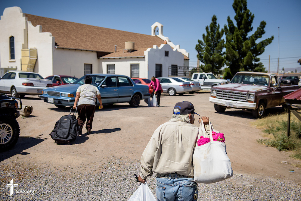 Food distribution recipients leave Saturday, May 21, 2016, at Ysleta Lutheran Mission Human Care in El Paso, Texas. LCMS Communications/Erik M. Lunsford