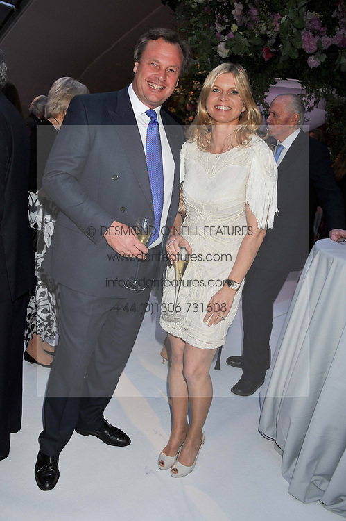 The MARQUESS & MARCHIONESS OF MILFORD HAVEN at a dinner hosted by Cartier following the following the opening of the Chelsea Flower Show 2012 held at Battersea Power Station, London on 21st May 2012.