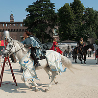 MILAN, ITALY - JUNE 05:  A woman wearing a medieval costume takes part mounted games, with the backdrop of Castello Sforzesco at the 1st Palio Citta' di Milano  on June 5, 2010 in Milan, Italy. The Palio Citta di Milano is a re-enactment of a medieval tournament in which only women partake as commemoration of the courage displayed by local women during the Vigevano siege of 1449.  (Photo by Marco Secchi/Getty Images)