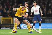 Juan Foyth defender of Tottenham Hotspur holds up Wolverhampton Wanderers forward Raul Jimenez (9) during the Premier League match between Wolverhampton Wanderers and Tottenham Hotspur at Molineux, Wolverhampton, England on 3 November 2018.
