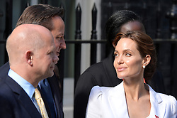 Image ©Licensed to i-Images Picture Agency. 10/06/2014.<br /> <br /> Angelina Jolie (right) meets the Prime Minister, David Cameron, and First Secretary of State, William Hague, at 10 Downing Street after attending the Global Summit to End Sexual Violence in Conflict at The ExCel, London, UK.<br /> <br /> Tuesday 10th of June 2014<br /> Picture by Ben Stevens / i-Images