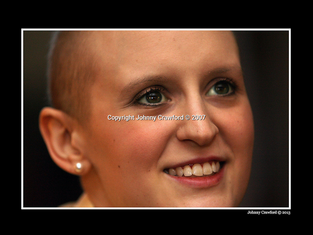 071120 ATLANTA,GA: Georgia Tech student and football fan Sara Keene  inside her home in Fayetteville,GA on Tuesday ,11/20/07.  She picked up some allies in her fight against leukemia namely Tech safety Djay Jones. ones helped organize the Sara Keene cookout, a cancer fundraiser in Keene's honor at which he and other Tech players cooked hamburgers and hot dogs. PHOTO BY JOHNNY CRAWFORD