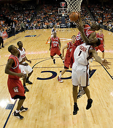 Virginia's Will Harris (1) fights for a rebound with Maryland's Ekene Ibekwe (25).  The Cavaliers defeated the #22 ranked Terrapins 103-91 at the John Paul Jones Arena in Charlottesville, VA on January 16, 2007.