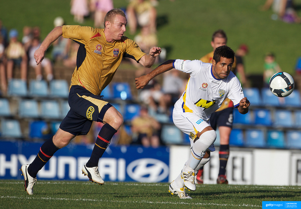 Jobe Wheelhouse (left) and Tahl Minniecon in action during the Newcastle Jets V Gold Coast United A-League match at Energy Australia Stadium, Newcastle, Australia, 13 December 2009. Photo Tim Clayton