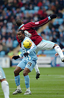 Photo: Kevin Poolman.<br />Coventry City v Burnley. Coca Cola Championship. 25/02/2006. Coventry's Stern John (L) and Micah Hyde clash over the ball.