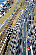 Nederland, Zuid-Holland, Rotterdam, 18-02-2015. A15 ter hoogte van Spijkenisse, ingang Botlekspoortunnel. Infrastructuur bundel, Betuweroute<br /> Motorway A15, connecting Port of Rotterdam with hinterland. Freight railway.<br /> luchtfoto (toeslag op standard tarieven);<br /> aerial photo (additional fee required);<br /> copyright foto/photo Siebe Swart