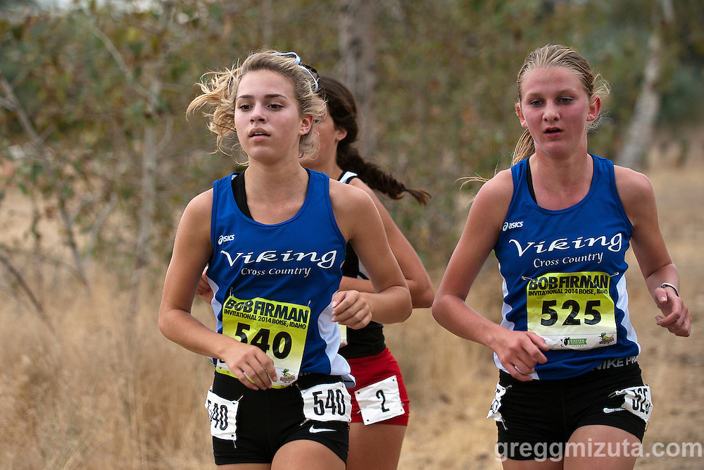 Coeur d' Alene senior Krista Story and sophomore Caitlin Conway on the second loop of  Bob Firman Invitational elite girls race on September 27, 2014 at Eagle Island State Park, Eagle, Idaho. Story 30th (19:19.36) and Conway 35th (19:22.31) to help their team to a third place finish (149) behind Utah teams Davis (53) and American Fork (72).