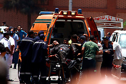 People transfer an injured man to an ambulance at the site of a bomb blast outside the presidential palace in Cairo, Egypt, June 30, 2014. Two police officers were killed and several other security personnel were wounded in two blasts near the presidential palace in Cairo. No group has yet claimed responsibility for the attacks. EXPA Pictures © 2014, PhotoCredit: EXPA/ Photoshot/ Ahmed Gomaa<br /> <br /> *****ATTENTION - for AUT, SLO, CRO, SRB, BIH, MAZ only*****