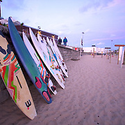 Surfs done for the day as the boards stack up against the wall as the late summer sky begins to give way to night