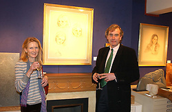 NICHOLAS & JULIA CRAIG HERVEY at an exhibition of portraits by Charmian Campbell held at Lucy B Campbell Fine Art, 123 Kensington Church Street, London W8 on 8th February 2005.<br /><br />NON EXCLUSIVE - WORLD RIGHTS