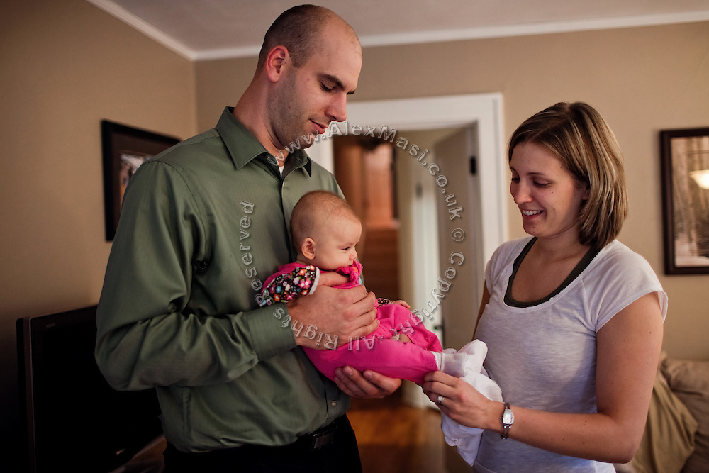 Benjamin Tippetts, 27, is looking after his newborn daughter with his wife, inside their home in La Crosse, WI, USA, where he works as a freelance financial advisor. Benjamin has been an Army infantryman in Fallujah, fighting in the 2nd battle in 2004. ......