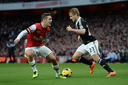 Arsenal's Jack Wilshere and Southampton's Luke Shaw compete for the ball - Photo mandatory by-line: Mitchell Gunn/JMP - Tel: Mobile: 07966 386802 23/11/2013 - SPORT - Football - London - Emirates Stadium - Arsenal v Southampton - Barclays Premier League