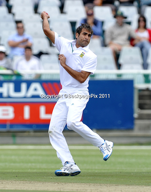 Imraan Tahir does the fielding off his own bowling. South Africa v Australia, first test, day 2, Newlands, South Africa. 10 November 2011<br /> <br /> <br /> &copy;Ryan Wilkisky/BackpagePix
