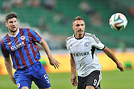 (R) Legia's Marek Saganowski fights for the ball with <br /> (L) Ken Oman of St Patrick's during Second qualifying round UEFA Champions League soccer match between Legia Warsaw and St. Patrick's Athletic at Pepsi Arena in Warsaw, Poland.<br /> <br /> Poland, Warsaw, July 16, 2014<br /> <br /> Picture also available in RAW (NEF) or TIFF format on special request.<br /> <br /> For editorial use only. Any commercial or promotional use requires permission.<br /> <br /> Mandatory credit:<br /> Photo by © Adam Nurkiewicz / Mediasport