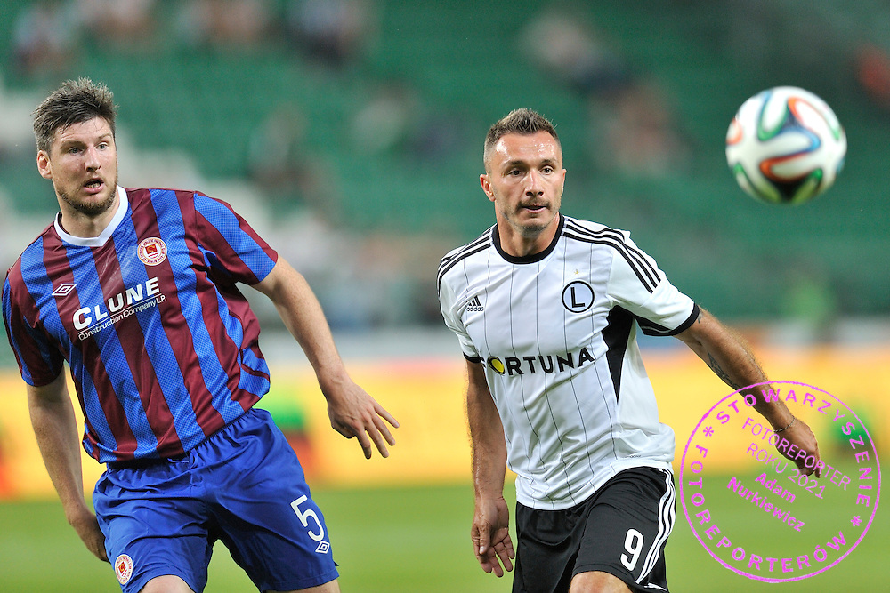 (R) Legia's Marek Saganowski fights for the ball with <br /> (L) Ken Oman of St Patrick's during Second qualifying round UEFA Champions League soccer match between Legia Warsaw and St. Patrick's Athletic at Pepsi Arena in Warsaw, Poland.<br /> <br /> Poland, Warsaw, July 16, 2014<br /> <br /> Picture also available in RAW (NEF) or TIFF format on special request.<br /> <br /> For editorial use only. Any commercial or promotional use requires permission.<br /> <br /> Mandatory credit:<br /> Photo by &copy; Adam Nurkiewicz / Mediasport