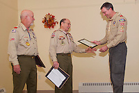 Gary Doucette for 26 years of service and Carl Gebhardt with 43 years of service receive dedication awards from Brian Roper and Boy Scout Troop 243 Wednesday evening at the Gilford Community Center.  (l-r)  Carl Gebhardt, Gary Doucette, Bill Klubben and Brian Roper  (Karen Bobotas/for the Laconia Daily Sun)