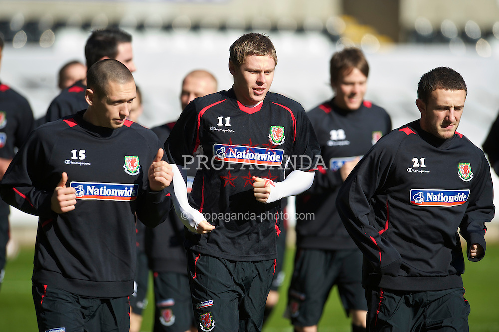 SWANSEA, WALES - Monday, March 1, 2010: Wales' Simon Church and Neal Eardley during training at the Liberty Stadium ahead of the international friendly match against Sweden. (Photo by David Rawcliffe/Propaganda)